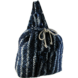Indigo Back Pack from El Salvador Exterior Dimensions 17 high x 14-1/2 wide x 3 diameter  with 2 - 31 straps, string closure, and open pocket inside