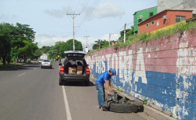 902b3b48e8c9 Collecting Tire Tubes Along the Road in El Salvador