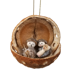 This Nativity Ornament is made from an Orange Peel.<br width=275 >Eucalyptus Pods are used for the bodies and white beans the heads.<br>It is produced by Artisans in Ecuador
