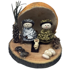 Mary and Joseph are made of Eucalyptus pods and standing on a natural wood base with an Orange Peel background.<br width=275 >Their Heads are made from white beans. - Handmade by Artisans in Ecuador