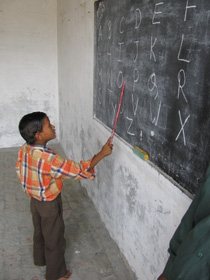 School Boy Learning Alphabet in Noah's Ark Sponsored School