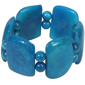 "Sky Blue Tagua Bracelet  Crafted by Artisans in Colombia  Measures 1-1/4"" wide x variable elastic diameter"