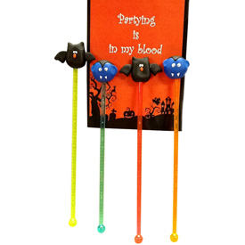 "Halloween Plastic Stir Sticks with Marzipan Ornaments Crafted by Artisans in Colombia Vampire Sticks Measure 7 1/8"" high x 1'' wide x 5/8'' deep Bat Sticks Measure 71/4'' high'' x 1 3/4'' wide x 1/2'' deep"