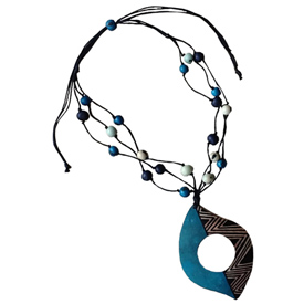 Teal Tribal Design Gourd Pendant with Acai Seeds Crafted by Artisans in Colombia Pendant Measures 3 1/2''h x 2 5/8''w Adjustable Beaded Cord Measures 7 1/4'' drop to 13 5/8''