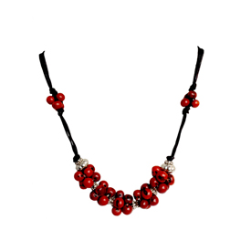 "Red Seed Necklace with Black cording and silver accents  Crafted by the Shipbo in Peru  Measures 22"" in length"