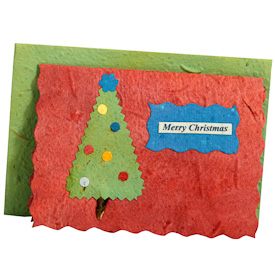 """Feliz Navidad""   crafted by Artisans in Peru from Handmade Paper   Measures 3-3/4"" x 5-1/4"", includes handmade paper envelope"
