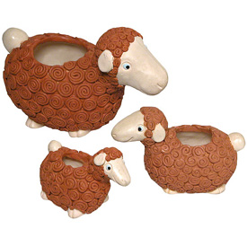 "Brown Ceramic Sheep from Bolivia  Small Measures - 3-1/2"" long x 1-3/4"" wide x 3-1/2"" high Medium Measures - 4-1/2"" long x 2-1/4"" wide x 3-1/4"" high Large Measures - 6-1/2"" long x 3-1/4"" wide x 4-1/4"" high"