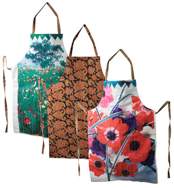 "Assorted Flower Print Aprons  Crafted by Artisans in India  Each measures about 35"" high x 25-1/2"" wide, with a kalamkari backing"