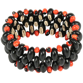 """Medium Black Seed Bracelet with Red Accents and Elastic Band  Crafted by Artisans in Colombia  Measures 1-1/4"""" wide with variable diameter"""